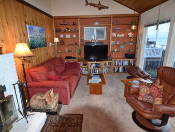 One suite shows a cozy living room with ample seating, nautical decor, and ocean views