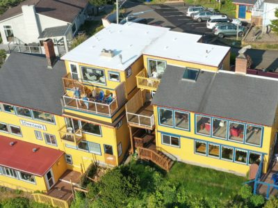 An arial view of the inn shows all of the west, ocean facing windows plus decks and patios.